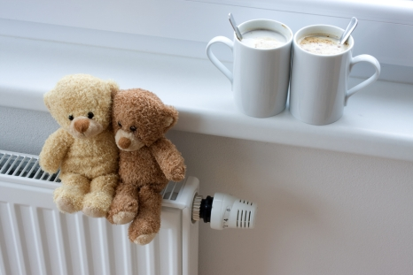 Teddy bears on a radiator.